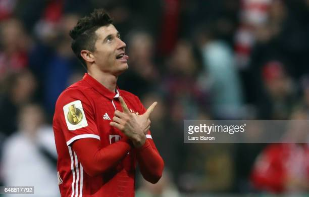 Robert Lewandowski of Muenchen celebrates his team's first goal during the DFB Cup quarter final between Bayern Muenchen and FC Schalke 04 at Allianz...