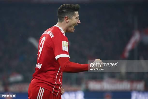 Robert Lewandowski of Muenchen celebrates his team's first goal during the Bundesliga match between FC Bayern Muenchen and FC Schalke 04 at Allianz...