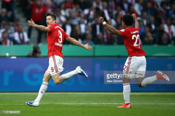 Robert Lewandowski of Muenchen celebrates his team's first goal with team mate Serge Gnabry during the DFB Cup final between RB Leipzig and Bayern...