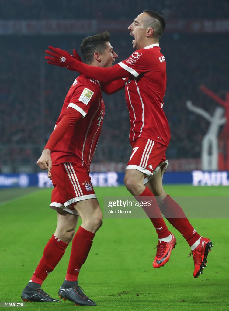 Robert Lewandowski of Muenchen celebrates his team's first goal with team mate Franck Ribery during the Bundesliga match between FC Bayern Muenchen and FC Schalke 04 at Allianz Arena on February 10, 2018 in Munich, Germany.