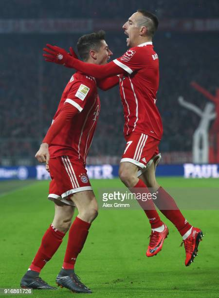 Robert Lewandowski of Muenchen celebrates his team's first goal with team mate Franck Ribery during the Bundesliga match between FC Bayern Muenchen...