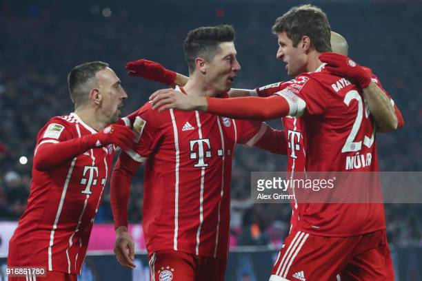 Robert Lewandowski of Muenchen celebrates his team's first goal with team mates during the Bundesliga match between FC Bayern Muenchen and FC Schalke...