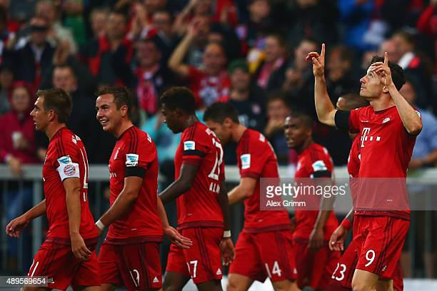 Robert Lewandowski of Muenchen celebrates his team's fourth goal with team mates during the Bundesliga match between FC Bayern Muenchen and VfL...