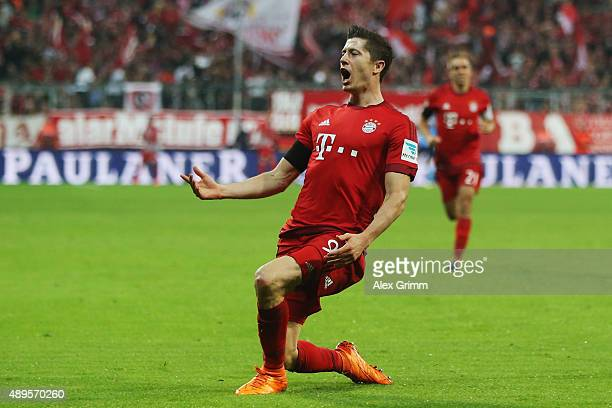 Robert Lewandowski of Muenchen celebrates his team's second goal during the Bundesliga match between FC Bayern Muenchen and VfL Wolfsburg at Allianz...