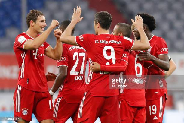 Robert Lewandowski of Muenchen celebrates his team's second goal with teammates during the DFB Cup semifinal match between FC Bayern Muenchen and...