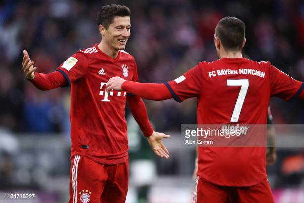 Robert Lewandowski of Muenchen celebrates his team's sixth goal with team mate Franck Ribery during the Bundesliga match between FC Bayern Muenchen...