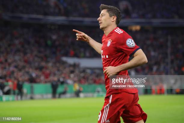Robert Lewandowski of Muenchen celebrates his team's third goal during the DFB Cup quarterfinal match between Bayern Muenchen and 1. FC Heidenheim at...
