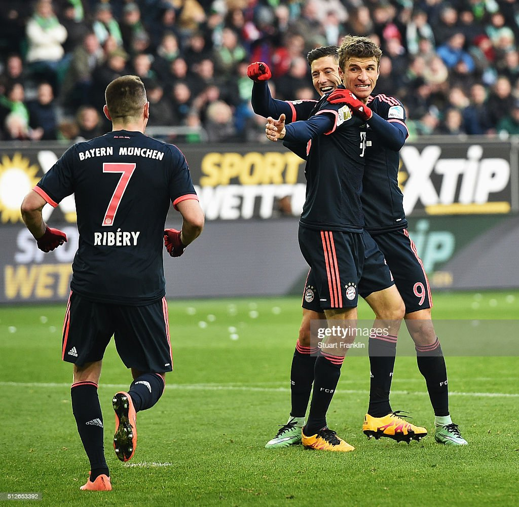 Robert Lewandowski of Muenchen celebrates scoring his goal with Thomas Mueller and Franck Ribery during the Bundesliga match between VfL Wolfsburg and FC Bayern Muenchen at Volkswagen Arena on February 27, 2016 in Wolfsburg, Germany.