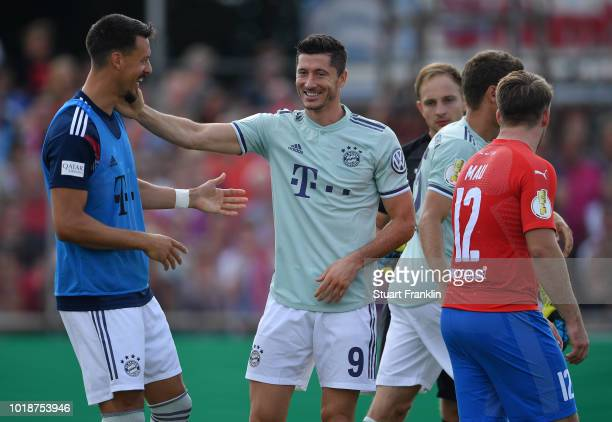 Robert Lewandowski of Muenchen celebrates scoring his goal with vduring the DFB Cup first round match between SV DrochtersenAssel and Bayern Muenchen...