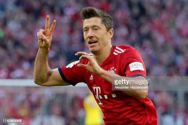 Robert Lewandowski of Muenchen celebrates scoring the 2nd team goal during the Bundesliga match between FC Bayern Muenchen and Borussia Dortmund at...