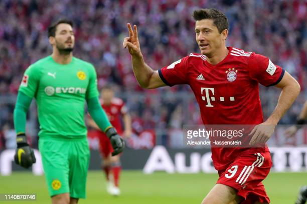 Robert Lewandowski of Muenchen celebrates scoring the 2nd team goal next to Roman Buerki, keeper of Dortmund during the Bundesliga match between FC...