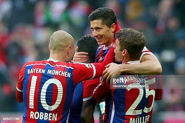Robert Lewandowski of Muenchen celebrates scoring the 6th goal with his team mates Thomas Mueller Juan Bernat and Arjen Robben during the Bundesliga...