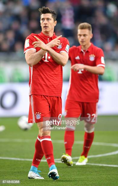 Robert Lewandowski of Muenchen celebrates scoring the second goal during the Bundesliga match between VfL Wolfsburg and Bayern Muenchen at Volkswagen...