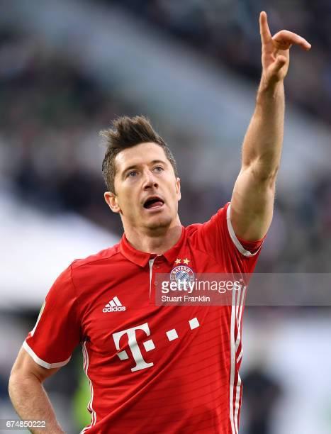 Robert Lewandowski of Muenchen celebrates scoring the third goal during the Bundesliga match between VfL Wolfsburg and Bayern Muenchen at Volkswagen...