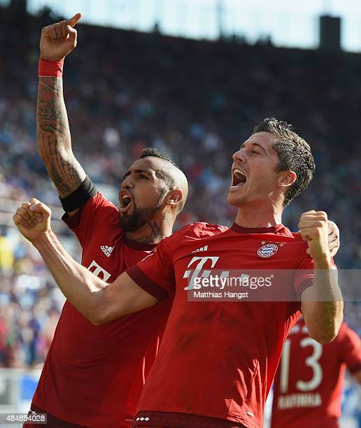 Robert Lewandowski of Muenchen celebrates with his teammates after scoring his team's second goal during the Bundesliga match between 1899 Hoffenheim...