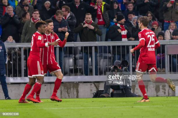 Robert Lewandowski of Muenchen celebrates with Kingsley Coman of Muenchen and Thomas Mueller of Muenchen after scoring his team`s third goal during...