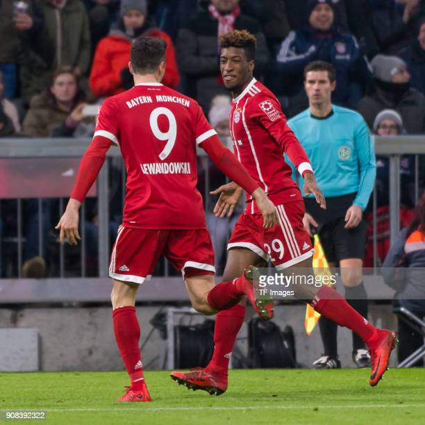 Robert Lewandowski of Muenchen celebrates with Kingsley Coman of Muenchen after scoring his team`s third goal during the Bundesliga match between FC...