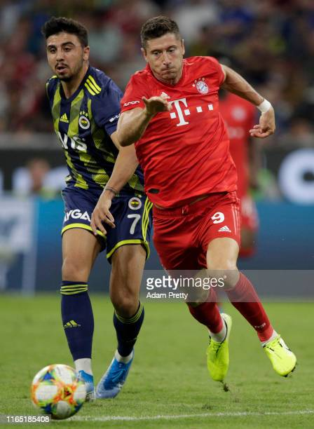 Robert Lewandowski of Muenchen challenges Ozan Tufan of Fenerbahce during the Audi Cup 2019 semi final match between FC Bayern Muenchen and...
