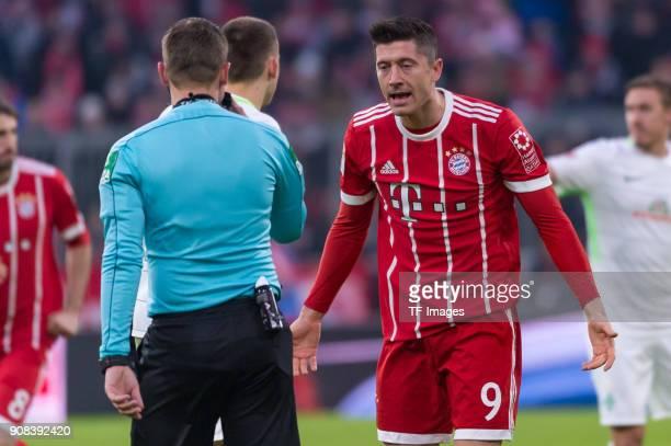 Robert Lewandowski of Muenchen complains to Referee Robert Kampka during the Bundesliga match between FC Bayern Muenchen and SV Werder Bremen at...