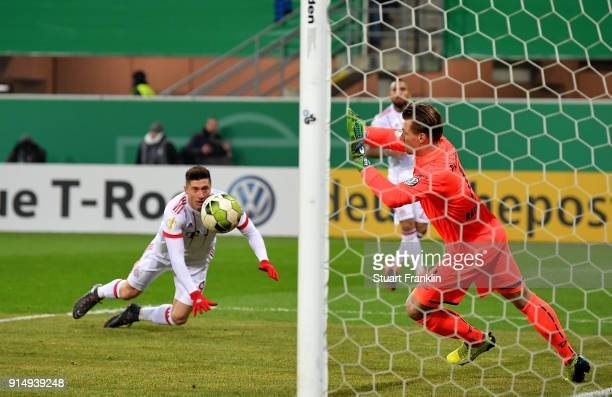 Robert Lewandowski of Muenchen fails to score the opening goal during the DFB Cup quarter final match between SC Paderborn and Bayern Muenchen at...