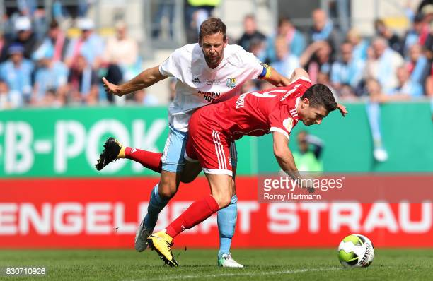 Robert Lewandowski of Muenchen is attacked by Marc Endres of Cottbus during the DFB Cup first round match between Chemnitzer FC and FC Bayern...