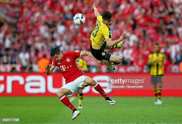 Robert Lewandowski of Muenchen is challenged by Julian Weigl of Dortmund during the DFB Cup Final 2016 between Bayern Muenchen and Borussia Dortmund...