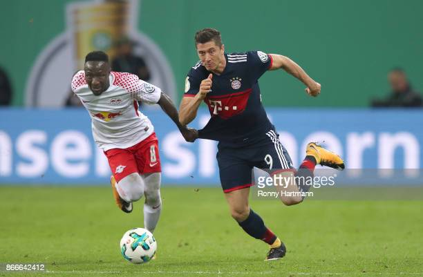 Robert Lewandowski of Muenchen is fouled by Naby Keita of Leipzig during the DFB Cup round 2 match between RB Leipzig and Bayern Muenchen at Red Bull...
