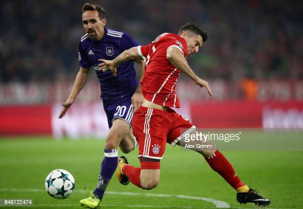 Robert Lewandowski of Muenchen is fouled for a penalty by Sven Kums of RSC Anderlecht during the UEFA Champions League group B match between Bayern...