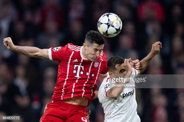 Robert Lewandowski of Muenchen jumps for a header with Gabriel Mercado of Sevilla during the UEFA Champions League Quarter Final second leg match...