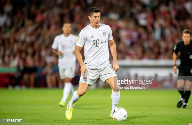 Robert Lewandowski of Muenchen plays the ball during the DFB Cup first round match between Energie Cottbus and FC Bayern Muenchen at Stadion der...