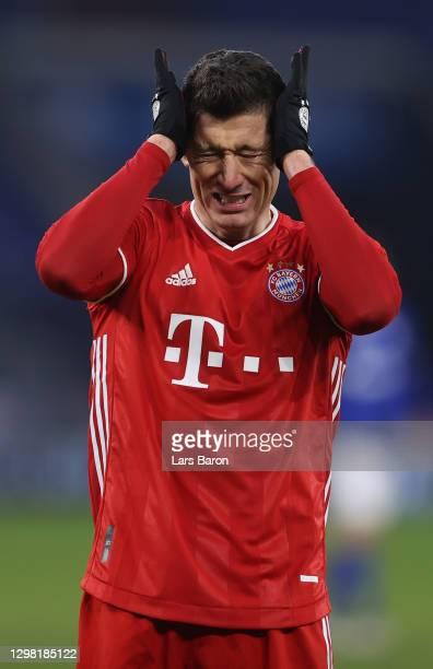 Robert Lewandowski of Muenchen reacts during the Bundesliga match between FC Schalke 04 and FC Bayern Muenchen at Veltins-Arena on January 24, 2021...