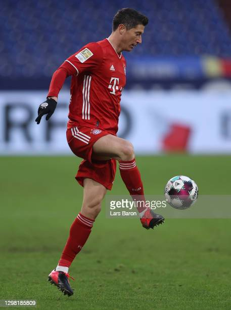 Robert Lewandowski of Muenchen runs with the ball during the Bundesliga match between FC Schalke 04 and FC Bayern Muenchen at Veltins-Arena on...