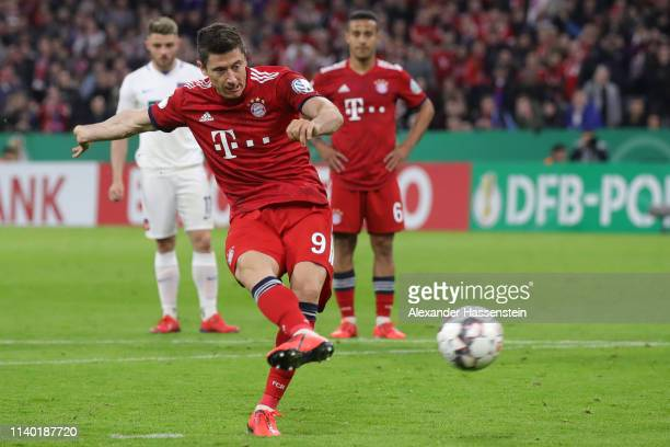 Robert Lewandowski of Muenchen scores his team's fifth goal from the penalty spot during the DFB Cup quarterfinal match between Bayern Muenchen and...