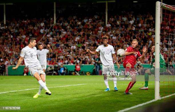Robert Lewandowski of Muenchen scores his team's first goal during the DFB Cup first round match between Energie Cottbus and FC Bayern Muenchen at...