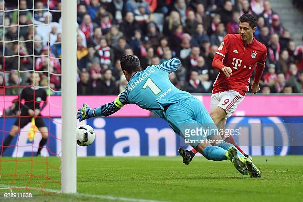 Robert Lewandowski of Muenchen scores his team's second goal past goalkeeper Diego Benaglio of Wolfsburg during the Bundesliga match between Bayern...