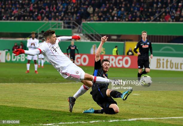 Robert Lewandowski of Muenchen scores the 2nd goal during the DFB Cup quarter final match between SC Paderborn and Bayern Muenchen at Benteler Arena...