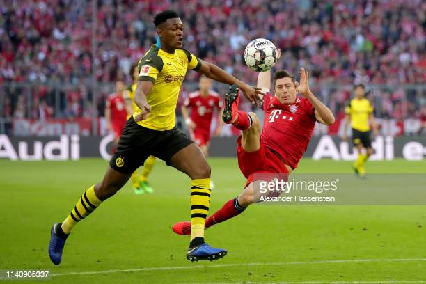 Robert Lewandowski of Muenchen scores the 2nd team goal against Dan-Axel Zagadou of Dortmund during the Bundesliga match between FC Bayern Muenchen...