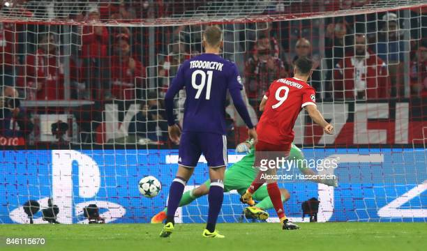 Robert Lewandowski of Muenchen scores the opening goal by penalty during the UEFA Champions League group B match between Bayern Muenchen and RSC...