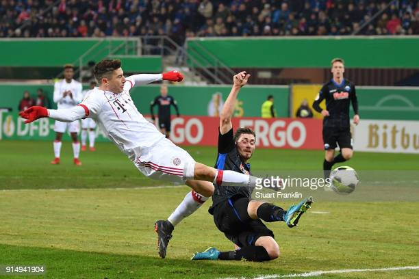 Robert Lewandowski of Muenchen scores the second goal during the DFB Pokal quater final match between SC Paderborn and Bayern Muenchen at Benteler...