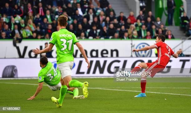Robert Lewandowski of Muenchen scores the second goal during the Bundesliga match between VfL Wolfsburg and Bayern Muenchen at Volkswagen Arena on...