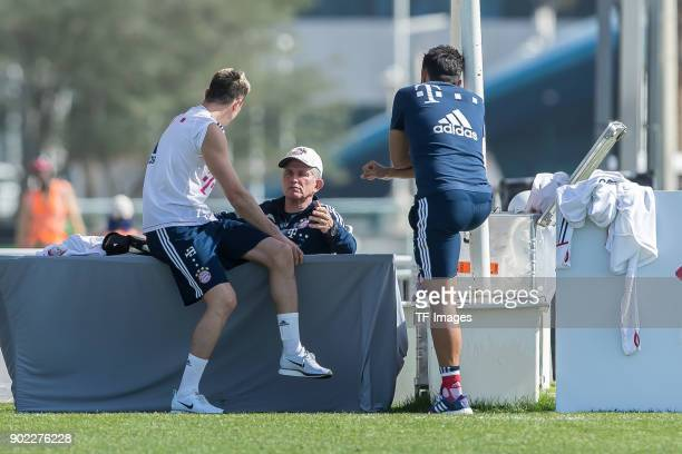 Robert Lewandowski of Muenchen speaks with Head coach Jupp Heynckes of Muenchen and Sporting director Hasan Salihamidzic of Muenchen during the FC...