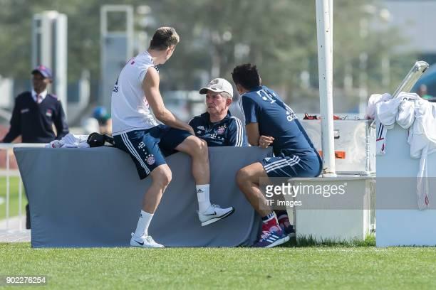 Robert Lewandowski of Muenchen speaks with Head coach Jupp Heynckes of Muenchen and Sporting director Hasan Salihamidzic of Muenchen during the FC...