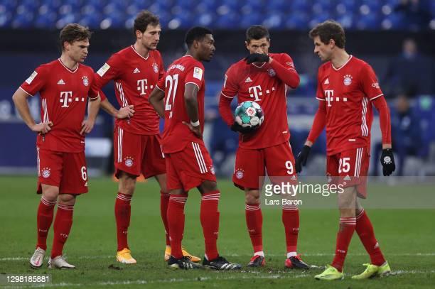 Robert Lewandowski of Muenchen speaks with team mate David Alaba during the Bundesliga match between FC Schalke 04 and FC Bayern Muenchen at...