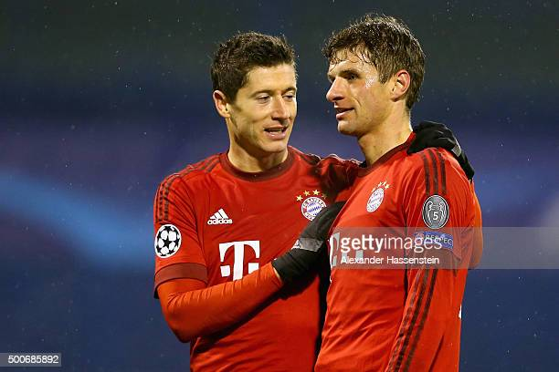 Robert Lewandowski of Muenchen talks to his team mate Thomas Mueller during the UEFA Champions League Group F match between GNK Dinamo Zagreb and FC...