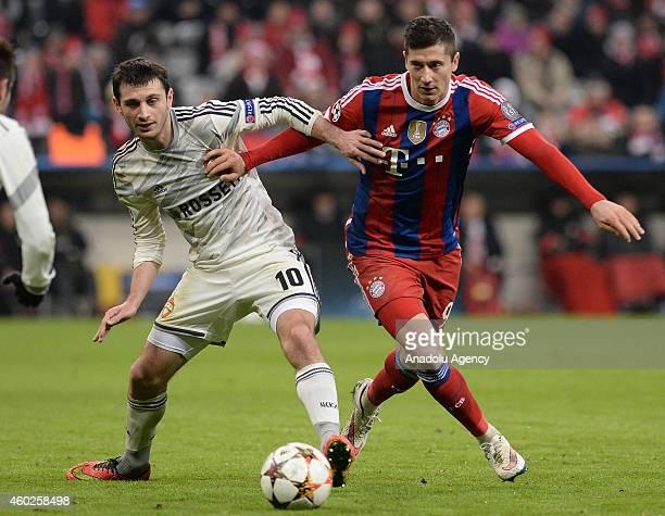 Robert Lewandowski of Munich and Alan Dzagoev of CSKA Moscow fight for the ball during the Champions League soccer match between FC Bayern Munich and...