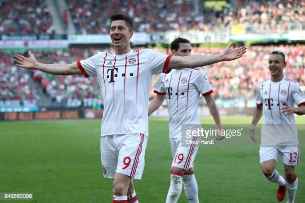 Robert Lewandowski of Munich celebrate after his first goal during the Bundesliga match between Hannover 96 and FC Bayern Muenchen at HDIArena on...