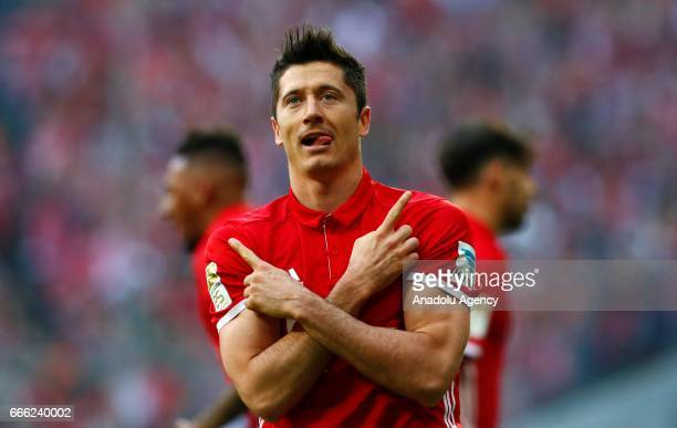 Robert Lewandowski of Munich celebrates a goal during the German Bundesliga soccer match between Bayern Munich and Borussia Dortmund at the Allianz...