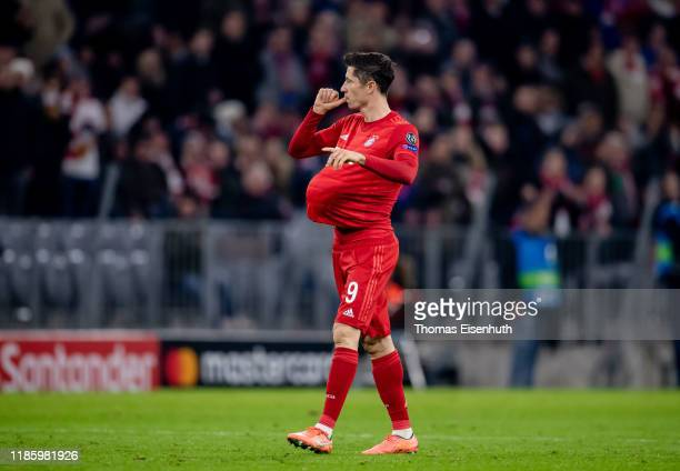 Robert Lewandowski of Munich celebrates after scoring the opening goal during the UEFA Champions League group B match between Bayern Muenchen and...