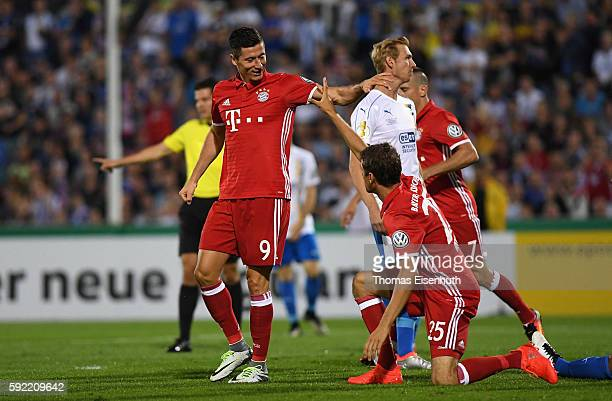 Robert Lewandowski of Munich celebrates with teammate Thomas Mueller after scoring the opening goal during the DFB Cup match between FC Carl Zeiss...