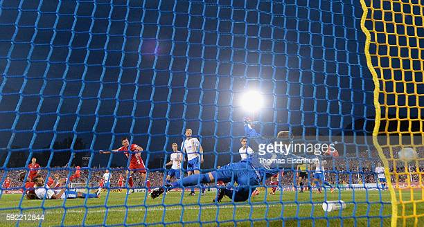 Robert Lewandowski of Munich scores the opening goal against goalie Raphael Koczor of Jena during the DFB Cup match between FC Carl Zeiss Jena and...